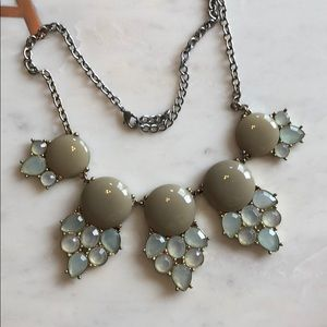 Adjustable green and taupe necklace.
